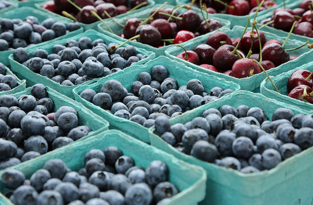 Blueberries and cherries at a market