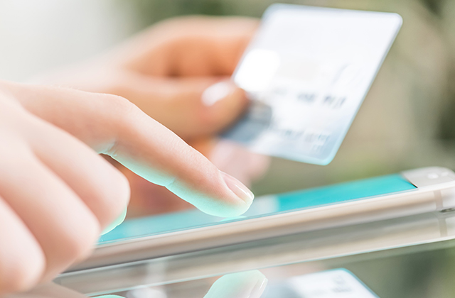 A person using a touch screen cell phone to make a payment